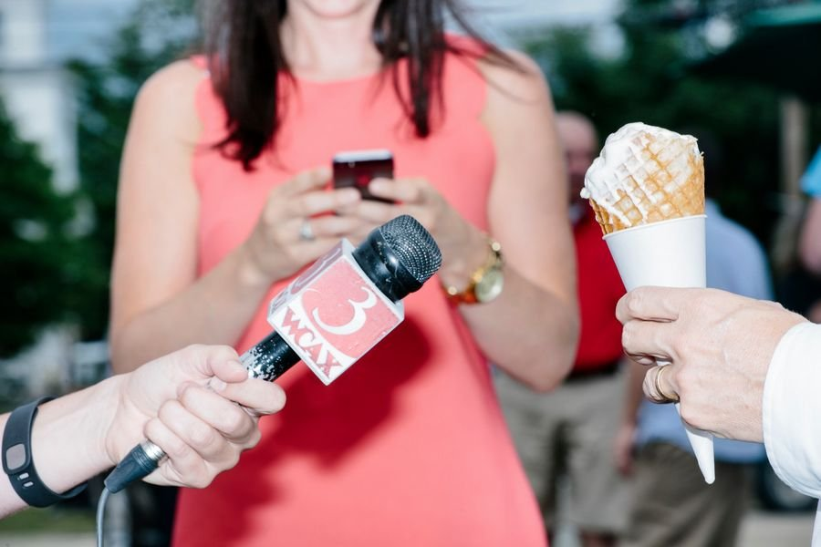Kentucky senator and Republican presidential candidate Rand Paul speaks to the media while eating ice cream during a campaign stop at Moose Scoops Ice Cream in Warren, New Hampshire.